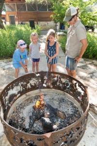 kids make s'mores at the firepit
